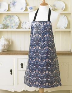 William Morris Strawberry Thief Pvc / Oilcloth Floral Apron This Licensed William Morris design was first produced in 1883. William Morris was inspired to to produce this design after watching the birds steal his strawberries from under the fruit nets at Kelmscott Manor. The apron is 100% Cotton which has been coated in a soft feel clear gloss pvc coating. The apron has been printed, pvc coated and manufactured in the UK. The pvc apron is wipe clean.