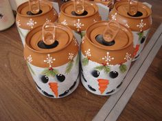 Recycled Snowmen small soda cans