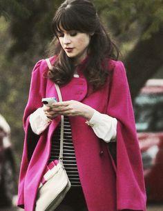 Zooey Deschanel in a hot pink cape