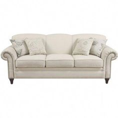 Wood-framed sofa with oatmeal-hued upholstery and nailhead trim. Product: SofaConstruction Material: Linen-blend and woodColor: OatmealFeatures: Accent pillows includedDecorative nailhead trim detailing Dimensions: H x W x D Nebraska Furniture Mart, Chicago Furniture, Living Room Sofa, Living Room Furniture, Dining Room, Cream Sofa, Coaster Fine Furniture, Sofa Couch, Couches