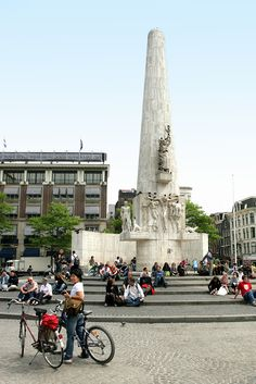 """De """"Dam"""" in Amsterdam, (Dam Square), where people congregate....to take a break, eat your sandwich...maybe play the guitar, sing, or converse with others..."""