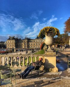 #Napping in the #autumn #sunshine #sitting under the #chrysanthemums in the #jardinduluxembourg #Paris