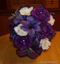 Brides tear shape bouquet at www.silkweddingflowersforless.com