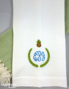 The pineapple, a symbol of hospitality, is part of the monogram on this waffle weave towel. NellyBelle Designs