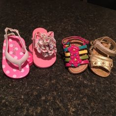Baby girl size 2 four pairs of sandals Baby girl 4 pairs of sandals size 2 slitty worn in nice condition.  Bundle 34 Shoes Sandals