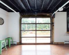 finished basement low ceiling glass garage door concrete floor - Google Search