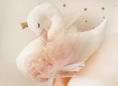 Lola the big swan, This beautiful magical swan made of cotton linen high quality fabric, has a gold shiny ribbon crown and wears her peach and pink tulle wings so softly. Her beak is made from light pink felt and eyes are hand embroidered. She measures 12 inches (30 cm) high and 17 inches