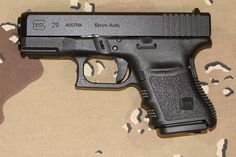 Glock 29 - 10mm. The most powerful Glock, in subcompact form. Massive firepower, insane ballistics. Destroys 9mm, .40 and .45's.