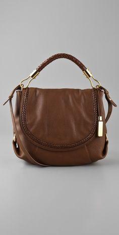 Michael Kors-Skorpios Shoulder Flap Bag.....hmm or maybe I need this one.