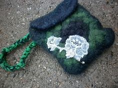 Crocheted & felted little purse from granny squares. Decorated with some lace and beads.