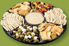 Mediterranean Party Platter from Jewel:  Sabra® Hummus, Stacy's® Pita Chips, wedges of pita bread, Mixed Olive Salad and Greek Feta Salad with pepperoncini and garden vegetables.