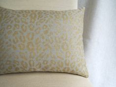 Gold leopard hand printed on warm gray linen home decor lumbar pillow case. $40.00, via Etsy. LOVE this!