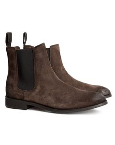 Something lovely about a guy in Chelsea boots! Rough looking style!