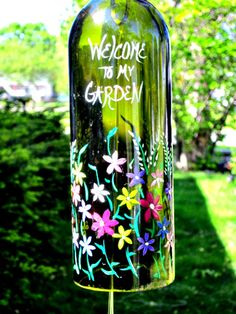 glass bottle crafts 47 Charming Backyard Ideas Using an Empty Glass Bottle Empty Glass Bottles, Glass Bottle Crafts, Wine Cork Crafts, Painted Wine Bottles, Wine Craft, Alcohol Bottles, Decorated Bottles, Glass Jars, Wine Bottle Chimes