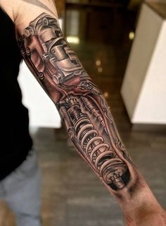 Coil over biomechanical tattoo Biomech Tattoo, Cyborg Tattoo, Biomechanical Tattoo Design, Robotic Arm Tattoo, Forearm Tattoos, Body Art Tattoos, Tribal Tattoos, Sleeve Tattoos, Tatoos