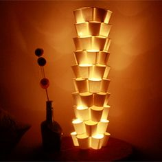 Cup dé light: Paper cups used for coffee, tea or water can be very easily recycled to make an eco-friendly exotic lamp. #craftgawker