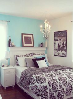 Love the color of wall, bedspread, and chandelier.