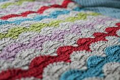 Ravelry: Happy Throw pattern by Mamachee  I've seen this done in a different palatte and the pattern really popped.