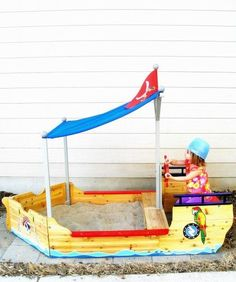 Filled with sand, a boat-shaped wooden box turns into a playspace that kindles the imagination on multiple levels.
