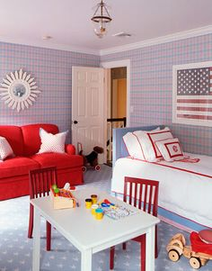 Designer Ashley Whittaker chose an American flag print by Maureen Andrews for Posh Papier for a kid's room in Southampton. White table and red chairs from Pottery Barn Kids. Bed linens from Leontine Linens.