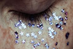 I love everything about this photo - the colour of the stars, her freckles and veins, how close the shot is. http://spindly-nightmares.tumblr.com