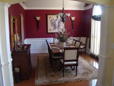 Classic Dining Room, Formal dining room in deep red with white wainscoting double crown moulding with uplighting wall sconces and 12 foot ceilings., Dining Rooms Design