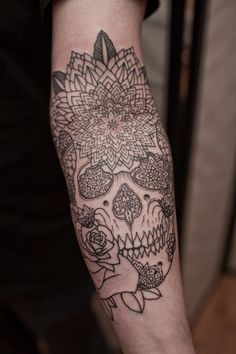 Flowers and a skull.