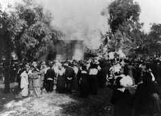 A crowd of extras watch a burning building during a silent film shoot at what used to be the Bonadiman farm in Edendale, located near what is now Benton Way in Silver Lake (just off the 101 Freeway). Photo circa 1915. (LAPL) Bizarre Los Angeles.
