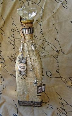 bottle + vintage =LOVE  Type something lovely on parchment paper.  Crumple and soak in tea to give an aged appearance and then wrap old bottles ~ from there...add trinkets you love