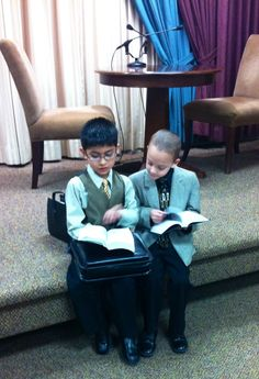 Kids reading the Bible at the Kingdom Hall after a meeting...these children are trained to be good readers and public speakers, and to know the Bible.
