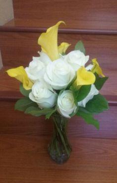 Yellow calla lilies, with white roses flower arrangement. #whiteyellowflowerarrangement #callaliiesrosesarrangement #mybouquetlv