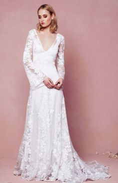 Bohemian chic floral lace embroidered bell sleeve wedding dress with deep v-neckline; Featured Dress: Odylyne The Ceremony