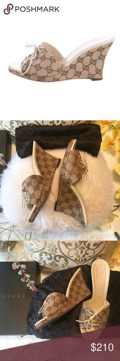 """Gucci GG Lace-Up Wedges So Cute and Classic Gucci Wedge Sandals! Brown and Tan GG Canvas Gucci Sandals with lace-up accents at tops and covered wedges. Size 6 1/2. Heels 3.75"""". In Great Used Condition. Normal wear on the bottom part shown in photos. Otherwise Great! Comes with box and dust bag . Love these ✨💖 Gucci Shoes Wedges"""