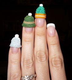 Dollhouse miniature crocheted hats.