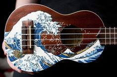 My brother gave me his old ukulele on the condition that I paint it. And paint it, I did. Based off of this thing that I'm sure you've seen b. The Great Ukulele off Kanagawa Ukulele Art, Ukulele Songs, Guitar Art, Cool Guitar, Music Songs, Guitar Deco, Cassandra Calin, Painted Ukulele, Drawing Tips