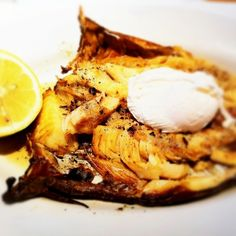 Hot buttered Arbroath smokie with poached egg