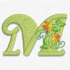 "This free embroidery design is from Cute Alphabet's ""Floral Alphabet"". It's the letter M."