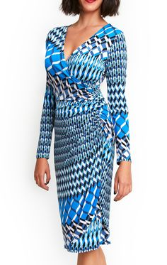 The Bianca Dress is an everyday pull on dress for busty women. Comfortable fit and contemporary print make this a style you'll just love to wear. Perfect for generously endowed of big bust women, this dress is both fun and stylish. The flattering mock wrap V-neck finishing with side ruching to showcase your curvy figure in style whilst disguising the mid-section. Fabulous for every day, work or party.