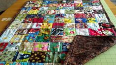 Eye Spy Quilt.  Give it to a kid with a list of things to find in the squares!