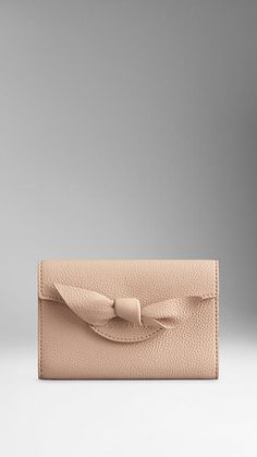 http://us.burberry.com/knot-detail-grainy-leather-continental-wallet-p39547531