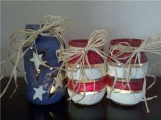 Turn mason jars into candle holders with these decorations for Memorial Day or 4th of July.