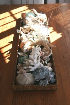shells and coral in a rattan tray on dining room table