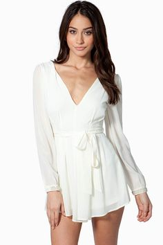 Skip the dress, and rock a sophisticated romper on date-night! Lightly pleated chiffon body. Deep v-neck and back. Long sleeves with embellished cuffs. Belt loops at the waist with a tonal self-tie. Concealed side zip closure. Wide leg shorts. Finished leg openings. Fully lined.