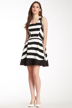 """Striped Drop Waist Dress by Harlyn   - Scoop neck - Sleeveless - 2 on-seam pockets - Hidden side zip closure - Lined - Approx. 36"""" length - Imported Fiber Content 60% polyester, 35% rayon, 5% spandex Color: Black & White Striped $228.00"""