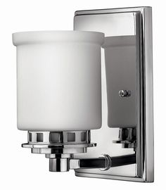 <p> 	Ashley vanity wall scone features etched opal glass shade with a chrome finish. Available in a 1, 2, 3, and 4 light option as well as a ceiling flush mount verison. One 100 watt, 120 volt, A19 incandescent lamp, not included. General light distribution. C-UL-us Dry listed.</p>
