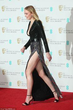 Sophie Turner in a high slit dress on the red carpet