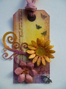Tag using distress inks, Dylusions and spellbinders.