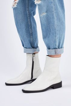 Sock boots are a staple this season, and we love this low-heel version in white. Crafted from soft leather, they include a zip to the side. #Topshop