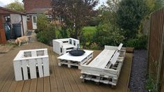 Pallet furniture. Four seater bench, 2 one seater chairs and table with fire pit centre.