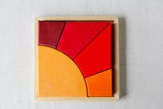 Sun Puzzle - pretty. Great for toddlers and motor skill development. Also good looking enough to have out on the coffee table.